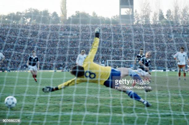 Dutch goalkeeper Jan Jongbloed is beaten by Archie Gemmill with a penalty kick for Scotland's 2nd goal during the FIFA World Cup match between...