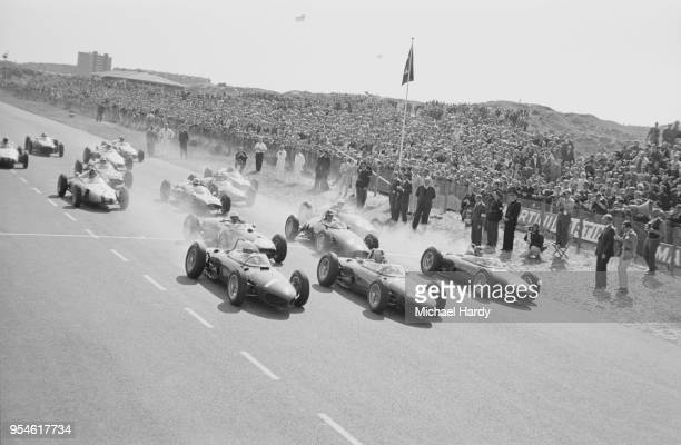 Dutch Grand Prix, Starting Grid: at the forefront Phil Hill driving Ferrari, Wolfgang von Trips driving Ferrari, and Richie Ginther driving Ferrari,...