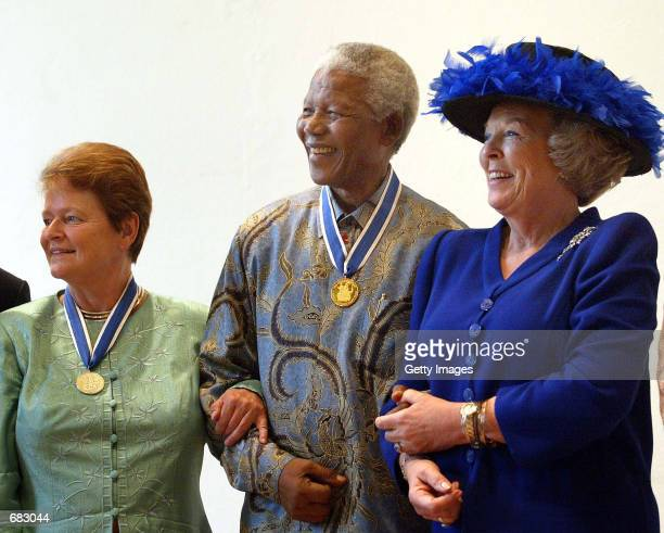 Dutch Gro Harlem Brundtland, the former prime minister of Norway, former president of South Africa Nelson Mandela and Dutch Queen Beatrix attend the...