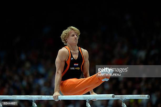 Dutch gymnast Epke Zonderland competes in the parallel bars event at the 44th Artistic Gymnastics World Championships in Antwerp on October 6 2013...