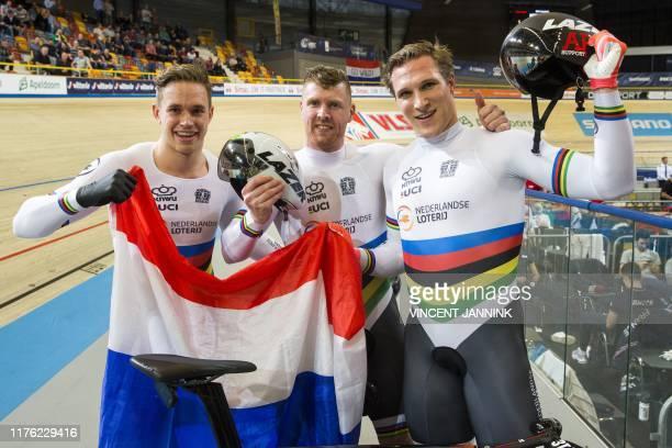 Dutch Harrie Lavreysen Roy van den Berg and Jeffrey Hoogland celebrate after winning the final round men team sprint at the European Championship...