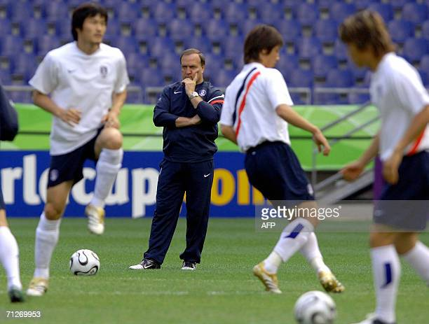 Dutch head coach of the South Korean team Dick Advocaat watches his team's players during a training session at the World Cup Stadium in Hanover, 22...