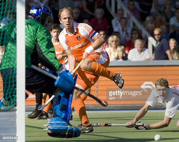 Dutch hockey player Teun de Nooijer gives the ball a hit so teamplayer Ronald Brouwer can make the 90 during the first pool match of the European...