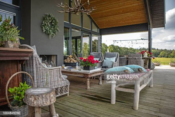 a dutch house with a deck and garden - wicker stock pictures, royalty-free photos & images
