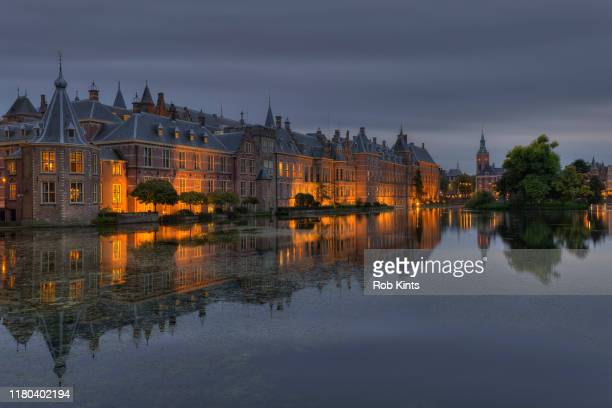 dutch houses of parliament ( binnenhof ) reflected in the court pond ( hofvijver ) - the hague stock pictures, royalty-free photos & images
