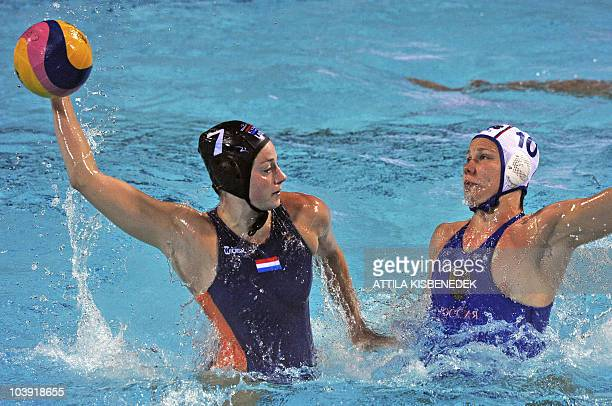 Dutch Iefke van Belkum shoots the ball against Russian Plga Balyaeva in the Mladost venue swimming pool of Zagreb on September 8 2010 during their...