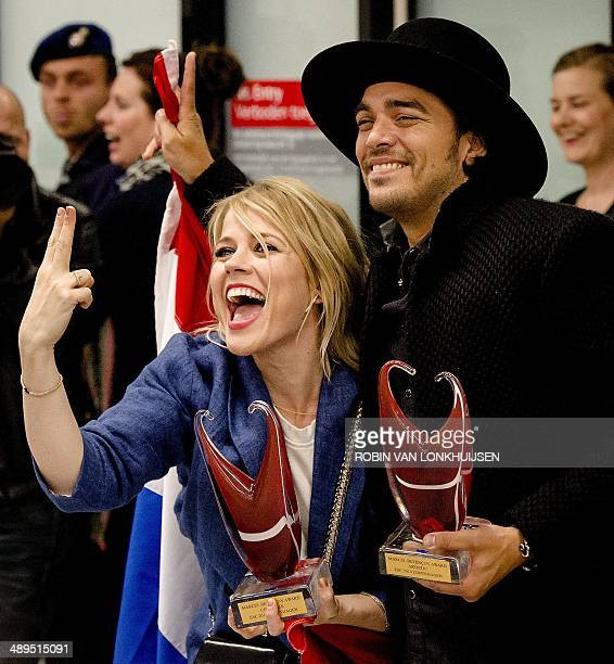 Dutch Ilse DeLange and Waylon of the band The Common Linnets arrive at Schiphol Airport in Amsterdam on May 11 after finishing second during the...