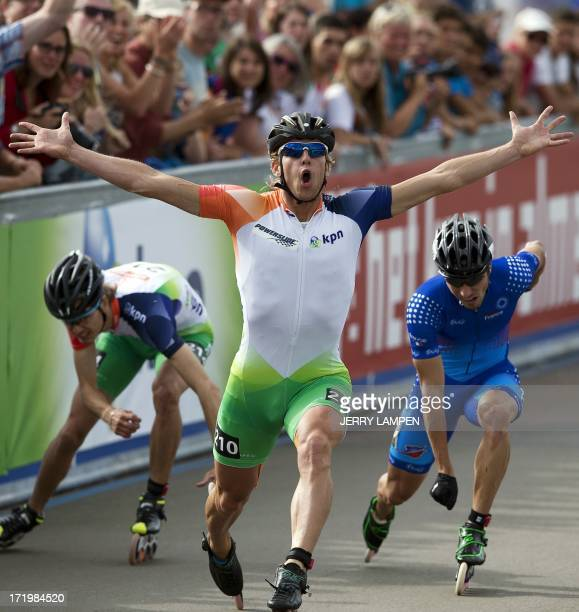 Dutch Inline skater Michel Mulder crosses the finish line and wins the 500m European Championship inlineskating in Almere The Netherlands on June 30...