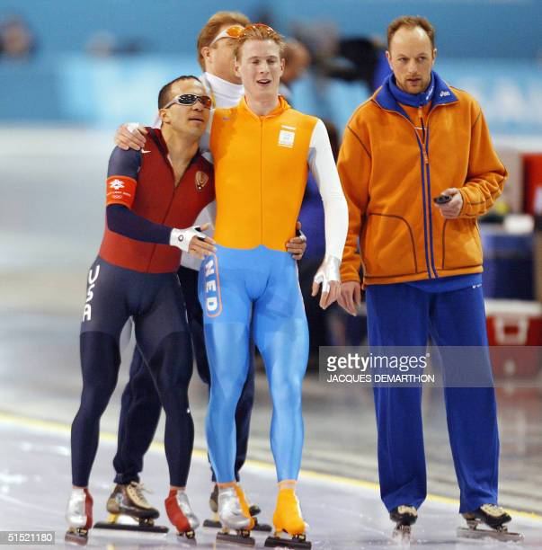 Dutch Jochem Uytdehaage comforts exhausted US Derek Parra after breaking countryman Gianni Romme's world record in 125892 in the men's 10000m speed...