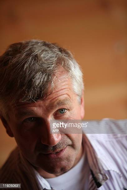 Dutch Johan Huibers poses on board of the 150 metrelong Noah's ark he created at an old abandoned quay on the Merwede River in Dordrecht on June 21...