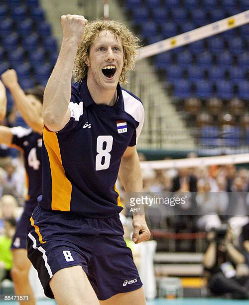 Dutch Kay van Dijk jubilates after his team defeated title holder and Olympic champion USA with 30 during their Volleyball World League 2009 match in...