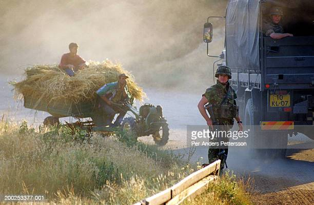 dutch kfor soldiers check vehicles at a roadblock outside pritzren, kosovo - per-anders pettersson stock pictures, royalty-free photos & images