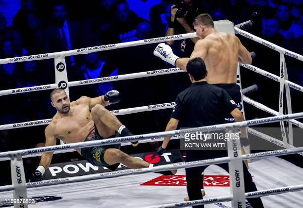 Dutch kickboxer Rico Verhoeven and Moroccanborn Dutch kickboxer Badr Hari fight during the rematch as part of the kick boxing event Glory Collision 2...