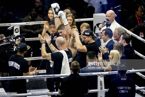 Dutch kickboxer Rico Verhoeven reacts after winning against Moroccan-born Dutch kickboxer Badr Hari during the kick boxing event Glory Collision 2,...