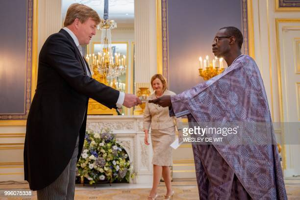 Dutch King Willem-Alexander accepts the diplomatic credentials of the Ambassador of the Republic of Senegal to The Netherlands, Momar Gueye, during a...