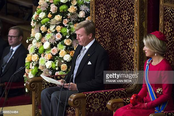 Dutch King WillemAlexander addresses the Dutch Senate and House of Representatives from the throne in the Hall of Knights next to Queen Maxima on...