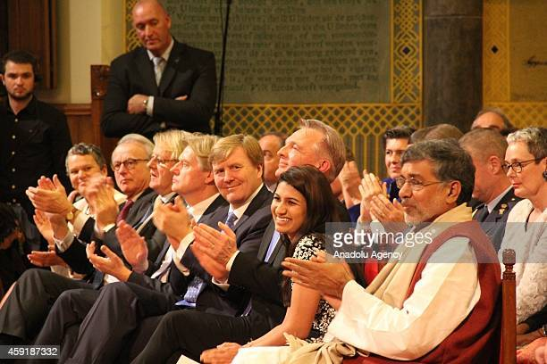 Dutch King WillemAlexander and American Neha Gupta received this year's prize applaud during the ceremony for the 10th International Childrens Peace...