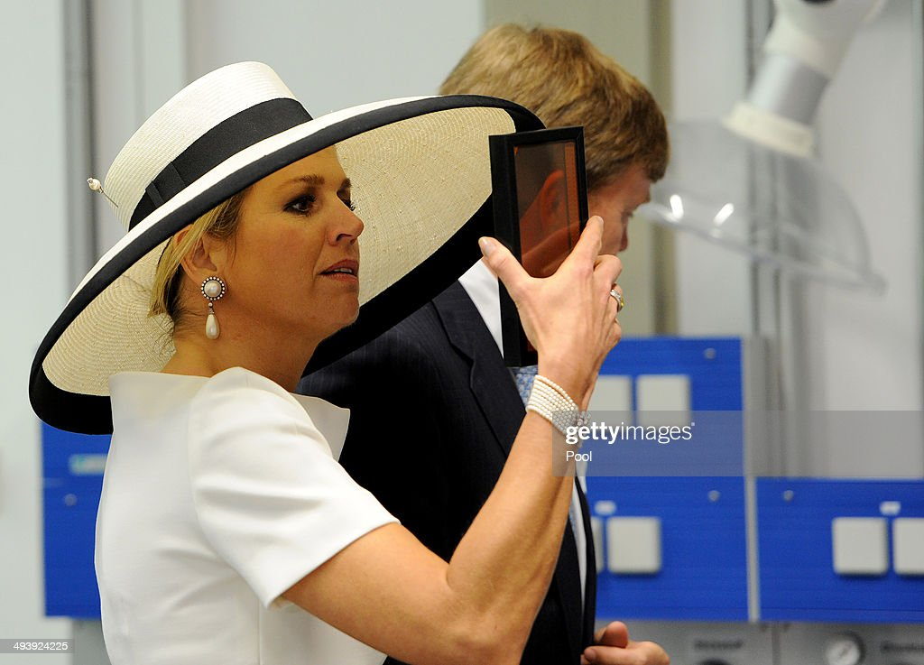 Dutch King Willem-Alexander and Dutch Queen Maxima during their visit of the EWE research center's laboratory 'Next Energy' on May 26, 2014 in Oldenburg, Germany.
