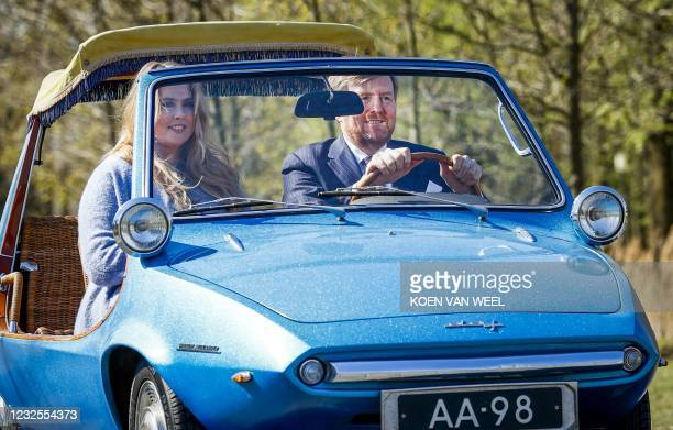 Dutch King Willem-Alexander and his daughter princess Amalia arrive in a DAF car for King's day celebrations, in Eindhoven, on April 27, 2021 during...