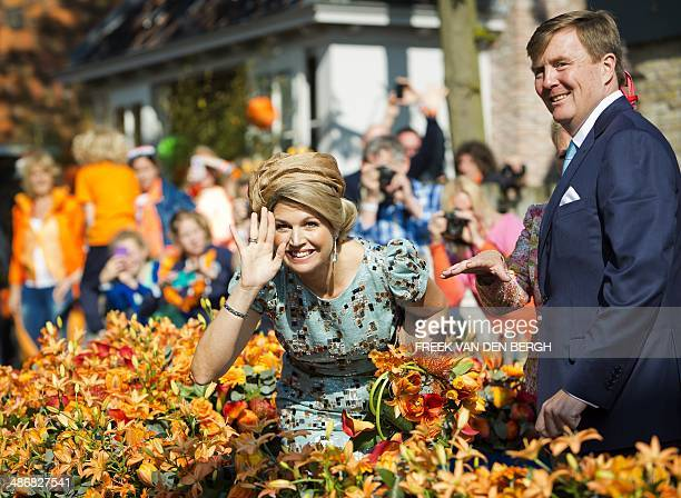 Dutch King WillemAlexander and his wife Queen Maxima parade during the celebrations of the firstever King's Day the birthday of the king in De Rijp...