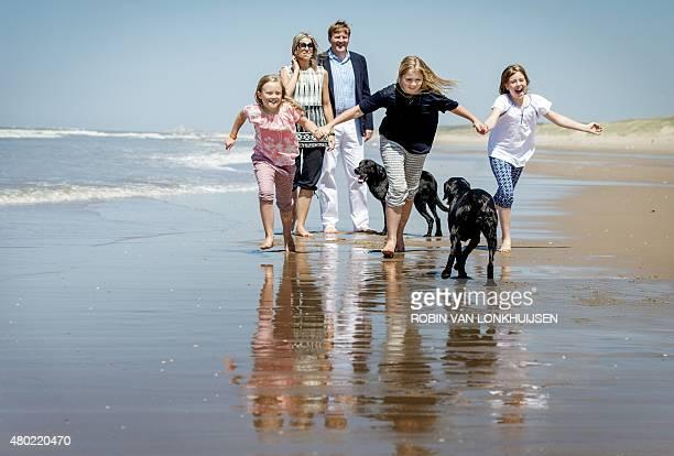 Dutch King WillemAlexander and his wife Queen Maxima walk as their three children Ariane Amalia en Alexia run during a photo call in Wassenaar on...