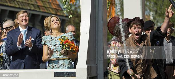 Dutch King WillemAlexander and his wife Queen Maxima watch a demonstration of the historical fire brigade during the King's Day celebrations in...
