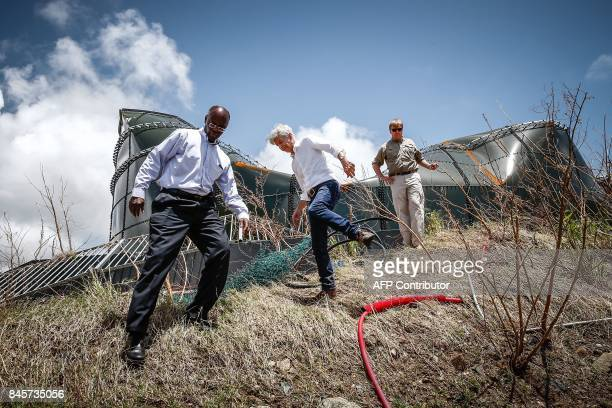 Dutch king WillemAlexander and Minister of Internal Affairs Ronald Plasterk visit a damaged watertank on September 11 at Filipsburg on the Dutch...