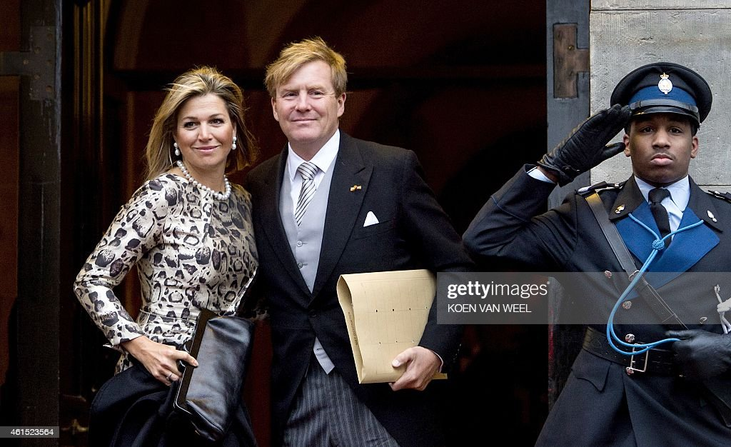 Dutch King Willem-Alexander (R) and Queen Maxima (C) arrive at the Royal Palace at the Dam Square, on January 14, 2015, for the traditional New Year's reception given by Dutch King Willem-Alexander and Queen Maxima for foreign diplomats stationed in The Netherlands.