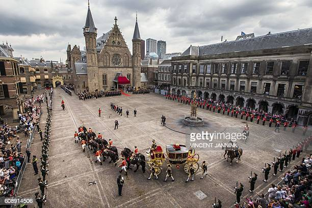 Dutch King WillemAlexander and Queen Maxima arrive in the Glass Carriage during the 'Prinsjesdag' at the Binnenhof in The Hague on September 20 2016...