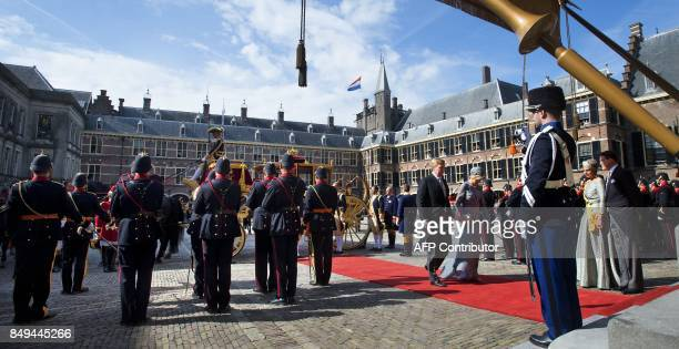 Dutch King WillemAlexander and Queen Maxima arrive in the Glass Carriage during the 'Prinsjesdag' at the Binnenhof in The Hague on September 19 2017...
