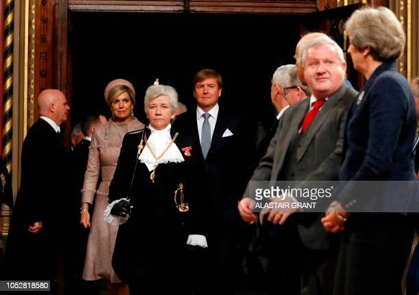 Dutch King Willem-Alexander and Queen Maxima arrive in the Royal Gallery at the Palace of Westminster in central London on October 23 on the first...