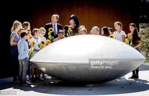 TOPSHOT Dutch King WillemAlexander and Queen Maxima attend the unvealing of the National Monument for the MH17 victims in Vijfhuizen on July 17 2017...