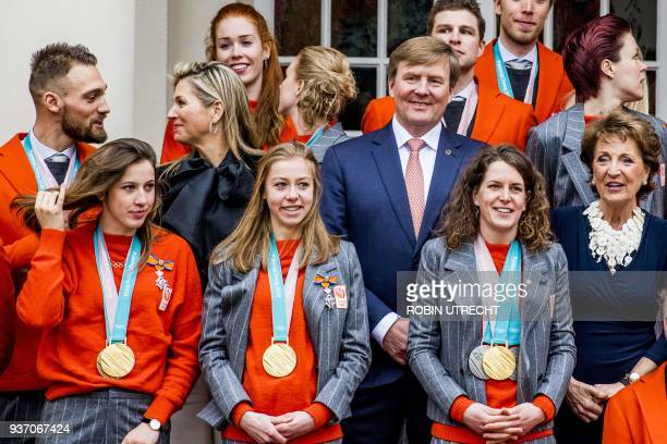 Dutch King WillemAlexander and Queen Maxima pose with Dutch Olympic and Paralympic medal winners of the Pyeongchang 2018 Winter Olympic Games in The...