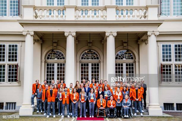 Dutch King Willem-Alexander and Queen Maxima pose with Dutch Olympic and Paralympic medal winners of the Pyeongchang 2018 Winter Olympic Games in The...