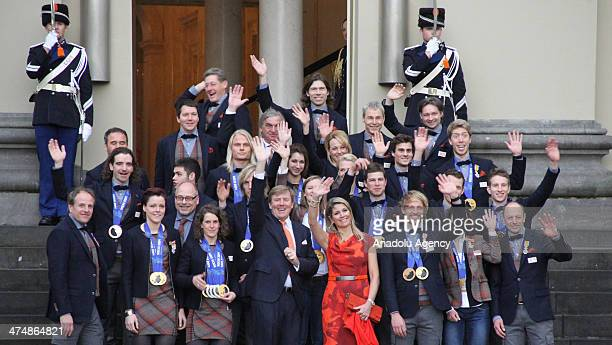 Dutch King Willem-Alexander and Queen Maxima pose with Netherlands' Sochi 2014 Winter Olympics medal winners at the Noordeinde Palace in The Hague,...