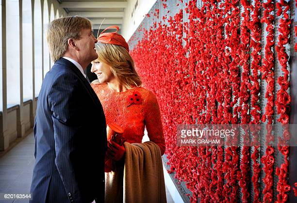 Dutch King WillemAlexander and Queen Maxima stop to place poppies on the wall of rememberence during a visit to the Australian War Memorial in...