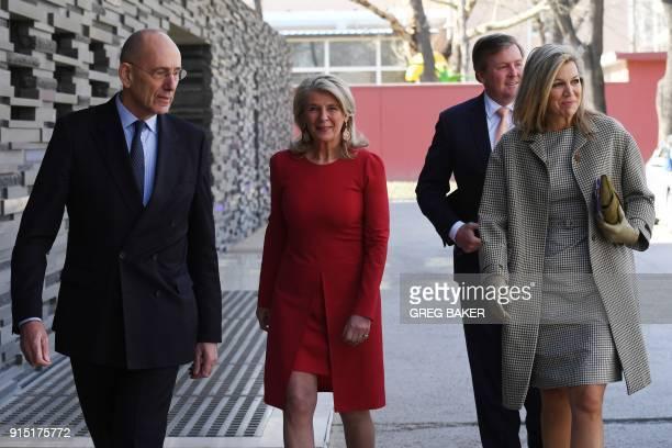 Dutch King WillemAlexander and Queen Maxima walk with Dutch Ambassador Ed Kronenburg and his wife Liliane Kronenburg at the Netherlands embassy in...