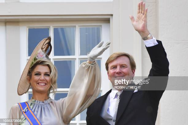 Dutch King Willem-Alexander and Queen Maxima wave to the crowd from the balcony of the Palace Noordeinde in The Hague, on September 18, 2018. -...