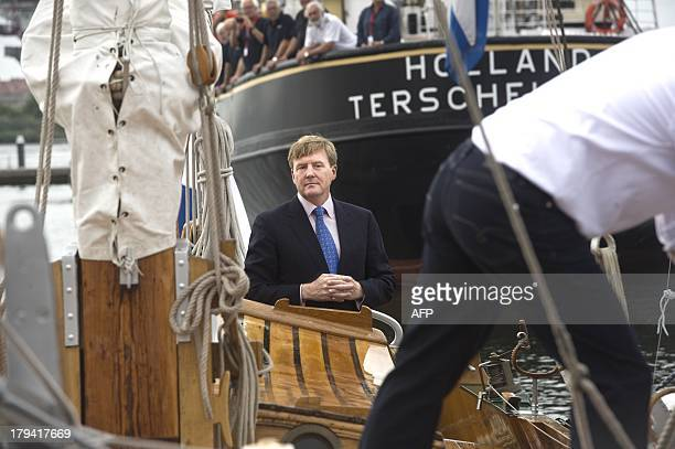 Dutch King WillemAlexander arrives on a boat for the opening of the 30th edition of the HISWA Symposium on yacht design and yacht construction at the...