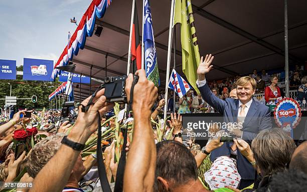 Dutch King WillemAlexander cheers participants at the finish line of the fourth and final day of the 100th edition of the International Four Day...