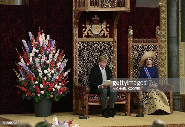 Dutch King WillemAlexander delivers a speech from the throne next to Queen Maxima sitting in the Ridderzaal during the 'Prinsjesdag' in The Hague on...