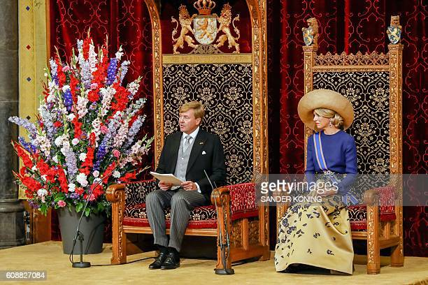 Dutch King WillemAlexander delivers his speech from the throne next to Queen Maxima sitting in the Ridderzaal during the 'Prinsjesdag' in The Hague...