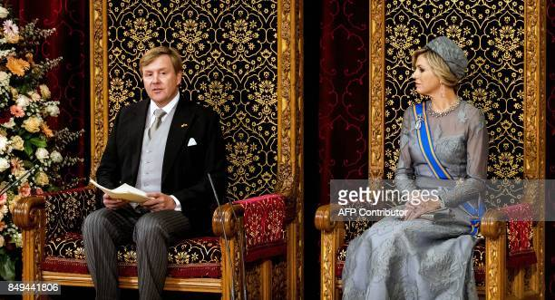 Dutch King WillemAlexander delivers his 'Speech from the Throne' next to Queen Maxima in the Ridderzaal during 'Prinsjesdag' in The Hague on...