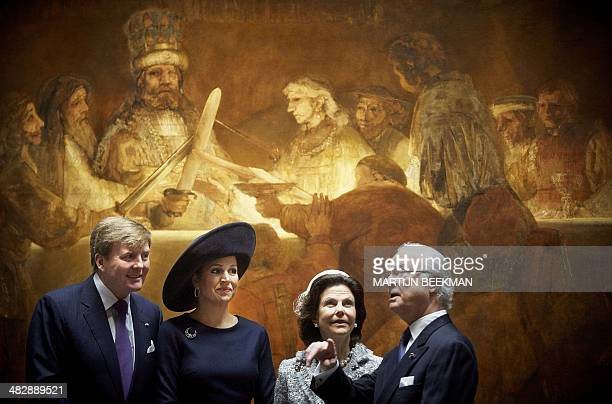 Dutch King WillemAlexander Dutch Queen Maxima Swedish King Carl Gustaf and Swedish Queen Silvia pose in front of the painting The Conspiracy of...