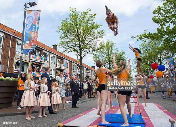Dutch King WillemAlexander his wife Queen Maxima and their daughters Princesses Amelia Alexia and Ariane look at some acrobatics during the King's...