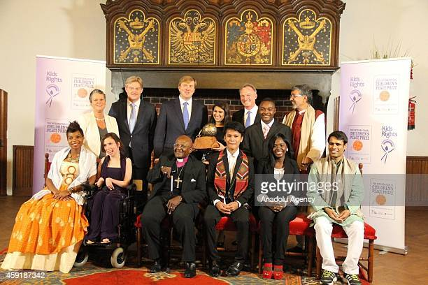 Dutch King WillemAlexander Nobel Prize owner Desmond Tutu and American Neha Gupta received this year's prize poses during the ceremony for the 10th...
