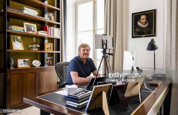 Dutch King WillemAlexander poses as he works in his office at Huis ten Bosch Palace in The Hague The Netherlands on April 20 2020 amid the COVID19...