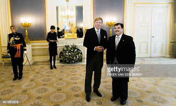 Dutch King WillemAlexander poses for a photograph the Afghan ambassador Obaidullah Obaid during a ceremony at the Noordeinde Palace in The Hague on...