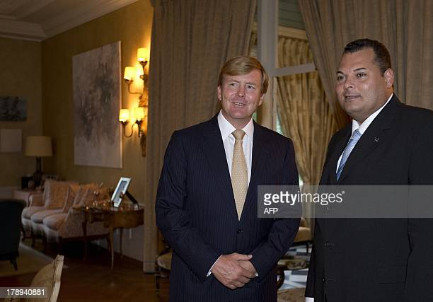 https://media.gettyimages.com/photos/dutch-king-willemalexander-poses-for-a-photograph-with-the-prime-of-picture-id178940881?s=612x612