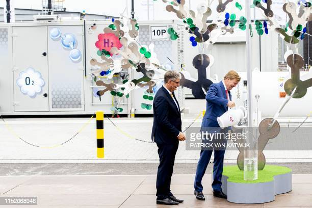 Dutch King Willem-Alexander pours water into a tube at the opening of the green hydrogen installation Hystock from Gasunie on June 26, 2019 in...